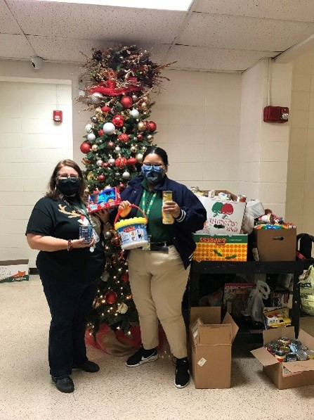 Two 4-H volunteers with toys collected for a toy drivejpg
